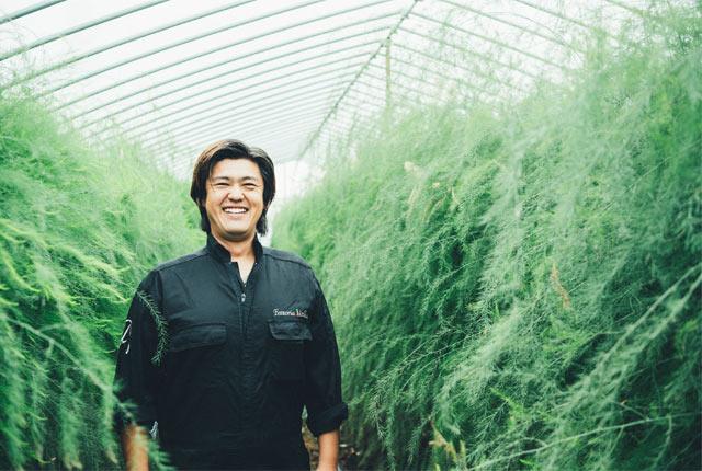 笑顔の飯塚さん